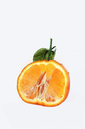 citrus reticulata: Tangerine (Citrus reticulata) cut against white background