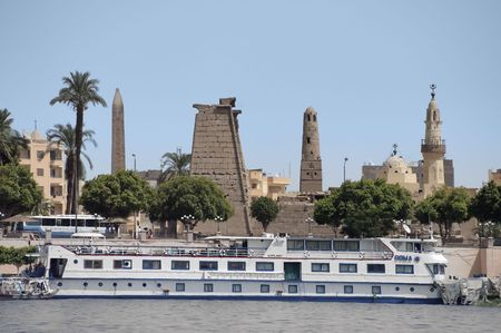Luxor pier with ancient ruins on background Stock Photo