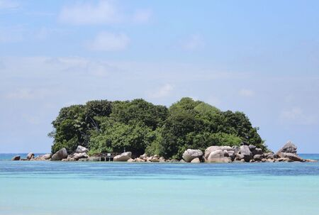 Tiny private island Chauve Souris covered in lush tropical vegetation , Seychelles Stock Photo - 884119