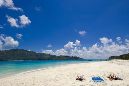 Tourists relaxing on Curieuse island beach, Seychelles Stock Photo - 952880