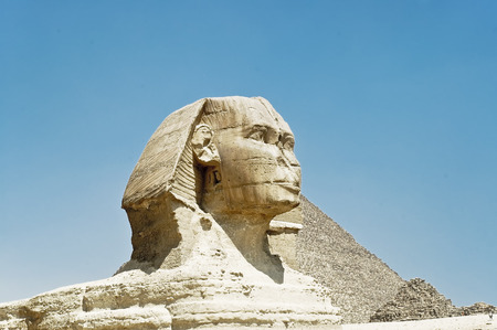 view from  south side  profile of Sphinx at Giza with Cheops piramid on background photo