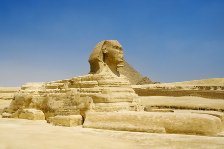 Half-lion Sphinx statue in Egypt on Giza Plateau at  west bank of  Nile River
