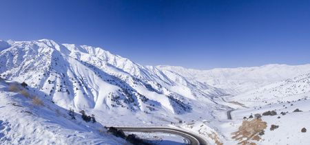 Looking out over mountain road  from Tashkent to Fergana valley with morning light and clear skies. It has an elevation of 2000 metres above sea level and often shrouded in snow. photo