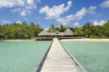 Jetty leading to restaurant and bar overlooking turquoise waters of Indian ocean Stock Photo