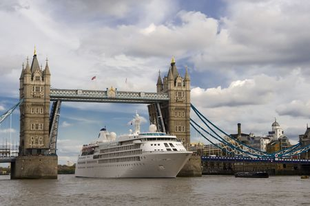Tourist ferry under Tower Bridge in heart of London  on Thames River photo