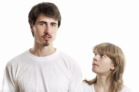smooching: Portrait of young man and woman against white background