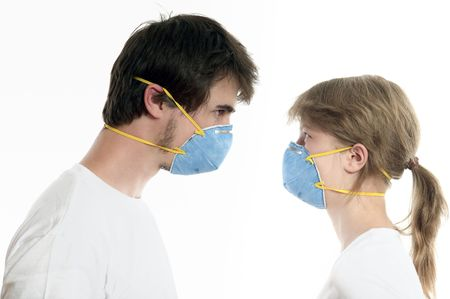 smooching: Man and woman 20-35 years  in blue respirators face to face against white background
