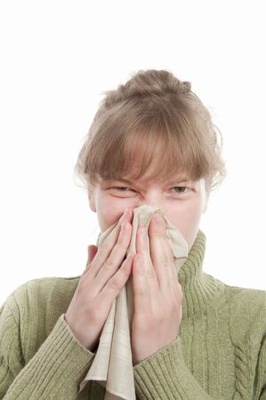 catarrh: Portrait of young  woman catched cold against white background Stock Photo