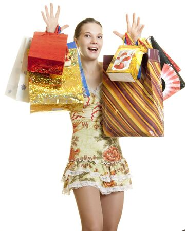 young woman brag of her purchases rising both hands with shopping bags   Stock Photo