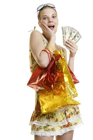 young woman holding shopping bags  in one hand and cash in other  photo