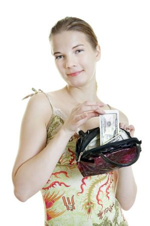 young smiling woman  takes cash out of her purse  full of money photo