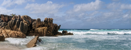 ashore: Picturesque boulders on the edge of Grand Anse beach, La digue island , Seychelles, Africa Stock Photo