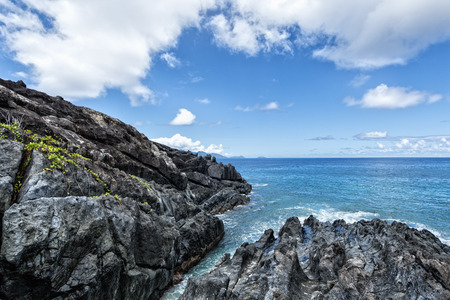 tout: Ramasse Tout  spectacular lava rock formations on the edge of Silhouette Island, Seychelles Stock Photo