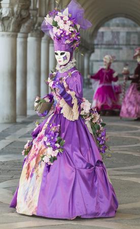 participant: Costumed carnival participant , San Marco Square,Venice, Italy
