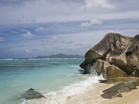 turquise: beach of La Digue island with Praslin island seen on background , Seychelles, Africa