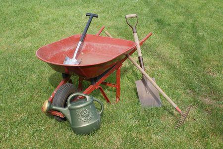 Wheelbarrow with gardening tools Standard-Bild