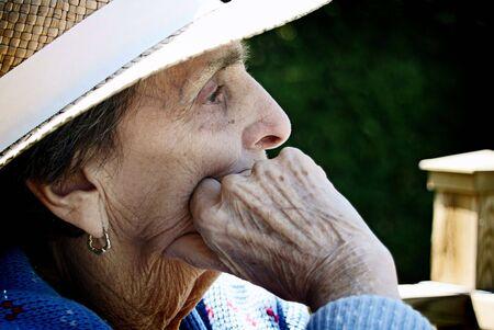 A close-up profile shot of an elderly, senior woman.