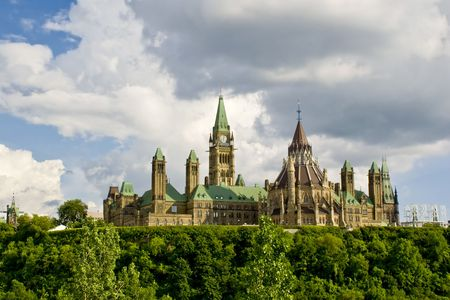 atop: Rear view of the Canadian Parliament buildings sitting atop Parliament Hill in Ottawa, Ontario, Canada.
