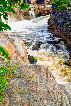 geological formation: A violent, gushing rapids cut through a geological formation known as a