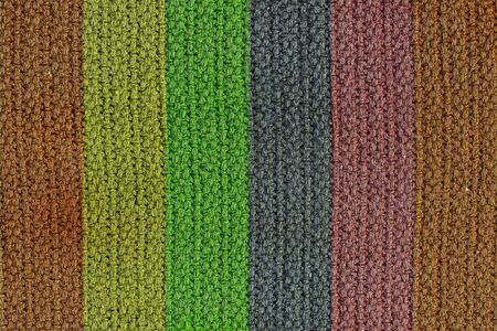 A texture background of a woven wool texture with vertical colored strips. photo