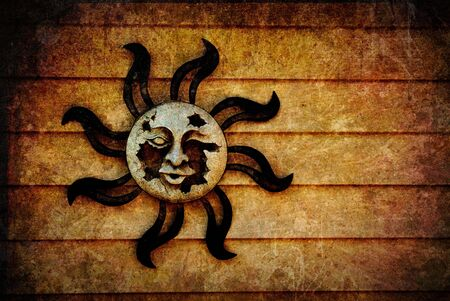 A broken, decaying pagan sun symbol with artistic, grunge style texture added and room for your text or images. Standard-Bild