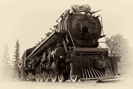 railway history: A 4-8-4, or Northern type steam train engine built by The Montreal Locomotive Works for Canadian National Railways in 1942. The photographic style simulates a vintage, early 20th century  late 19th century images.