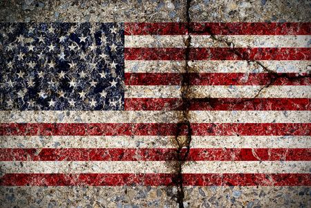 grunge background: A worn and fading American flag painted on a cracked concrete surface.