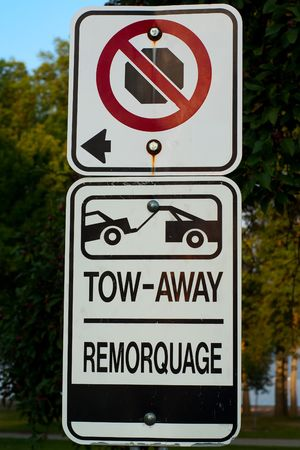 No stopping - no parking - tow-away zone street sign. photo