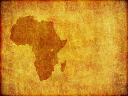 A background design of the continent of Africa imprinted on a piece of aged material.With plenty of copy-space.
