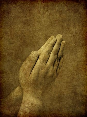 A set of praying hands - image has been textured and distressed to simulate an old and aged ambrotype photo from the Victorian era.