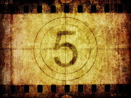 A distressed grunge background texture of an old slice of film negative with film leader countdown.