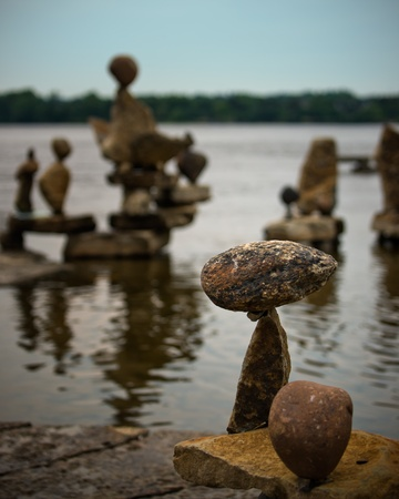 canada aboriginal: a small inuksuk (inukshuk) stands in the foreground with many more out of focus in the background.