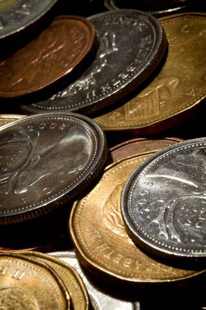 canadian coin: An extreme close-up macro photo of a random pile of various Canadian coins.