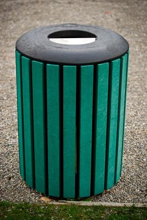 A unique, green, public trash bin.