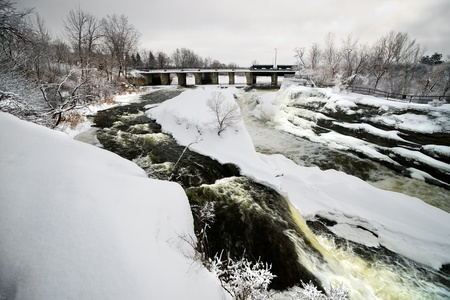 ice dam: Hogs Back falls located on the Rideau River in Hogs Back park in Ottawa, Ontario Canada frozen over in winter.