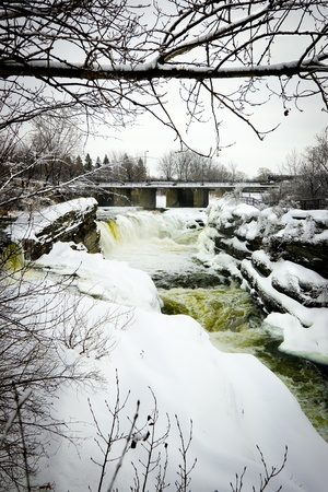 Hogs Back Falls - officially known as Prince of Wales Falls - frozen over in winter on the Rideau River in Hogs Back Park in Ottawa, Ontario Canada photo