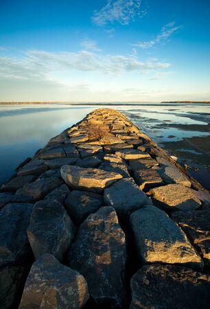 britannia: A long stone jetty stretches toward the horizon on the historic Ottawa River near Britannia beach. Stock Photo