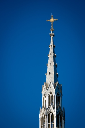catholicism: Bell tower steeple with gold cross of the historic Notre-Dame Cathedral Basilica in Ottawa, Canada. Stock Photo