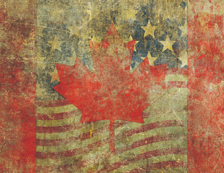 overlaying: Grunge style Canadian flag overlaying an the American flag both heavily distressed, damaged and faded with the appearance of being old paint on concrete. Stock Photo