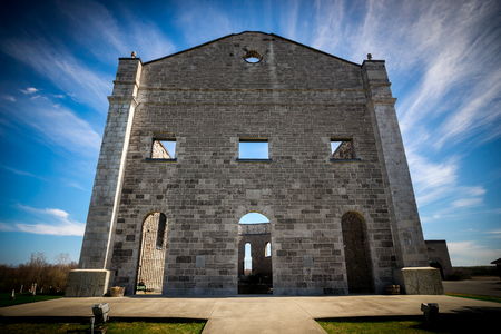 hallowed: Wide-angle shot of the towering front facade of St. Raphaels Ruins - a national historic site in South Glengarry, Ontario, Canada.