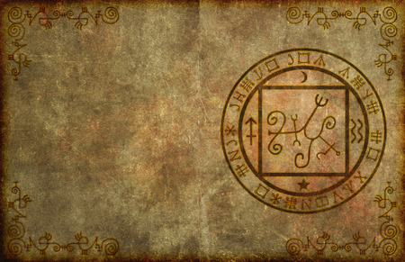 An ancient, textured paper page background with mystical magical occult sigil or seal and blank space for your copy. Foto de archivo