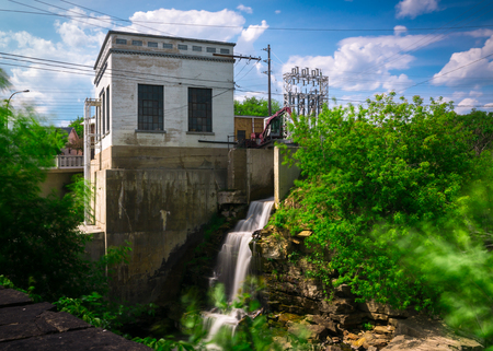 An old, small hydro-electric power generating station in Almonte, Ontario Canada with running waterfall captured in a timed exposure.