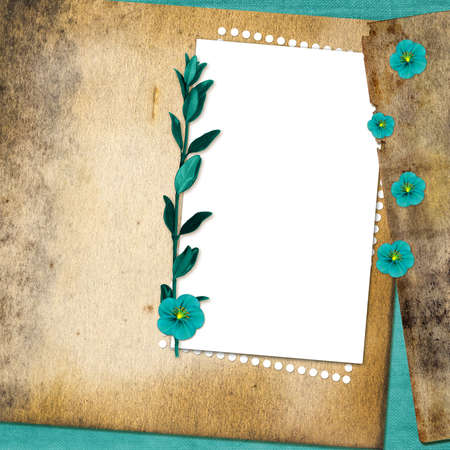 Sheet with flowers on old grunge background photo