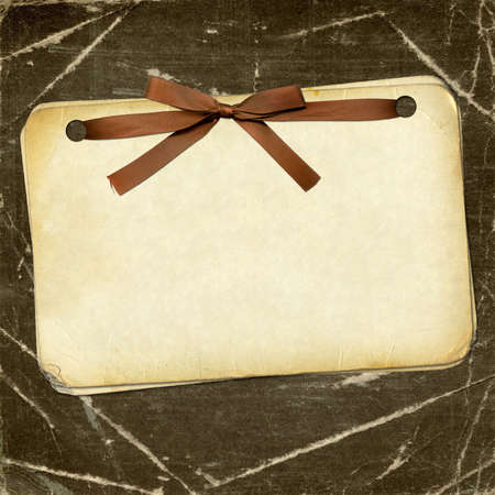 frayed: Grunge papers with bow on dark background