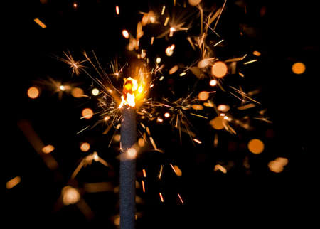 combust: Extra close up photograph of sparkler on a black background