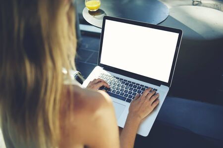space for type: Closely image of a female blogger type on laptop computer with blank copy space screen for your advertising text message, hipster girl chatting with friends in social network via portable net-book