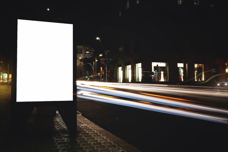 light streaks: Electronic empty billboard with copy space for your text message or content, public information board with light streaks on background, advertising mock up in urban setting, clear poster on roadway