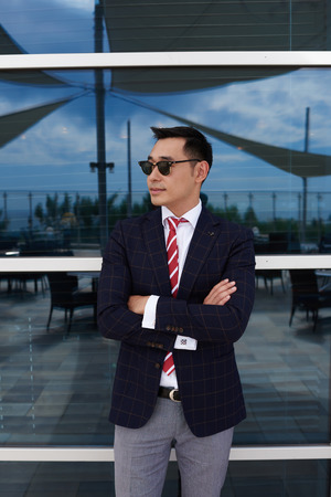 half dressed: Half length portrait of successful man ceo dressed in corporate clothes standing with crossed arms near office building, young confident managing director resting after business meeting with partners
