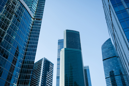 Moscow city with modern business skyscrapers, high-rise contemporary office buildings, architecture raising to the sky, exterior view of big company against blue sky background