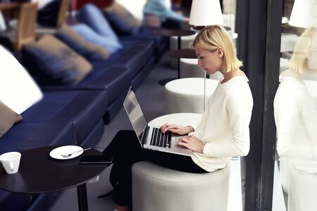 Modern business woman or young successful working on laptop computer while sitting at coffee shop interior, female student sitting in university library with net-book, internet distance work concept